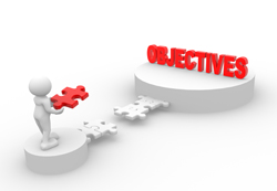 A figure holding a puzzle piece to connect a bridge to the word 'objectives'.